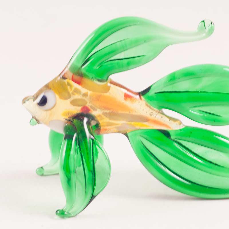 Рыба с зеленым хвостом Рыбы